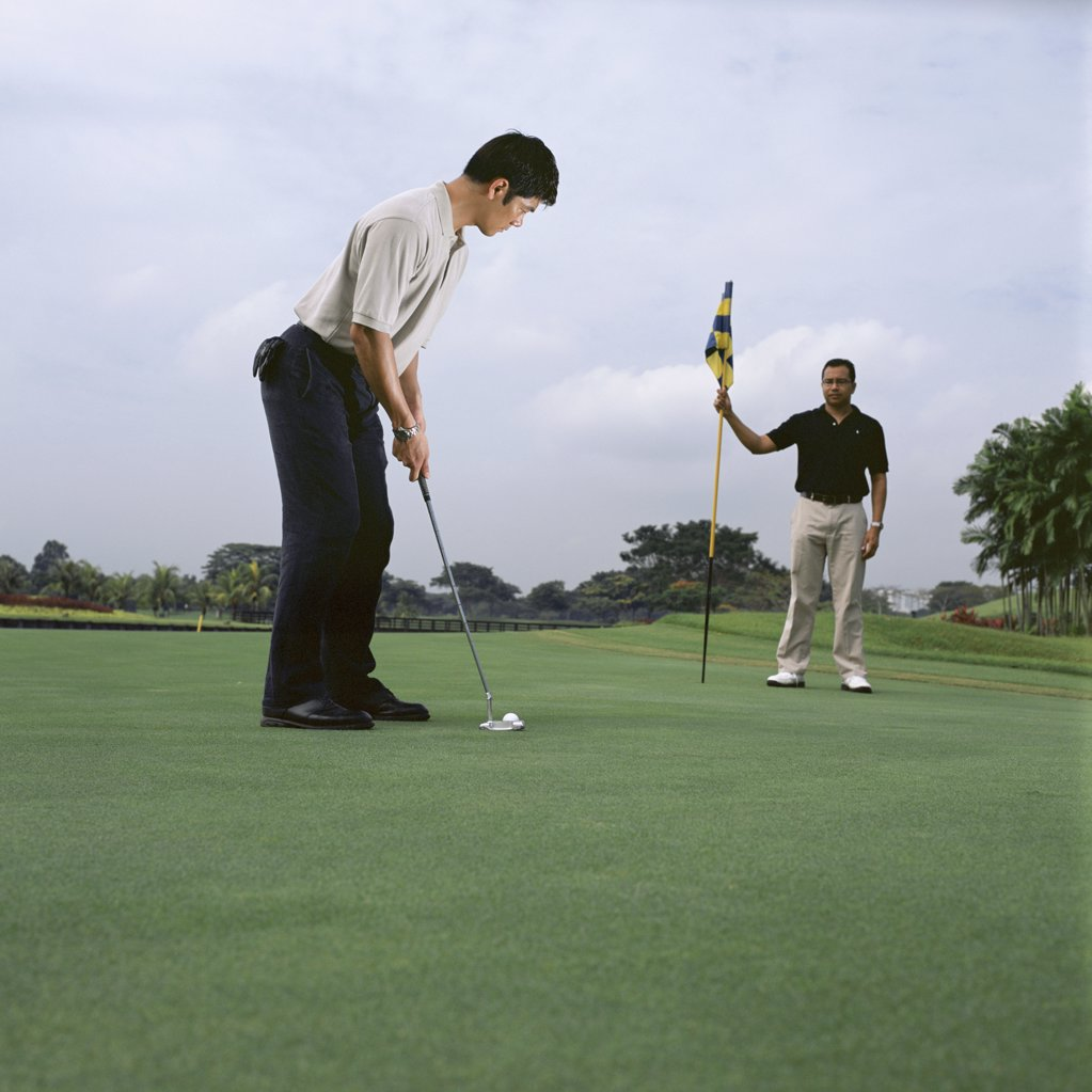 Stock Photo: 1439R-05317 Two men playing golf