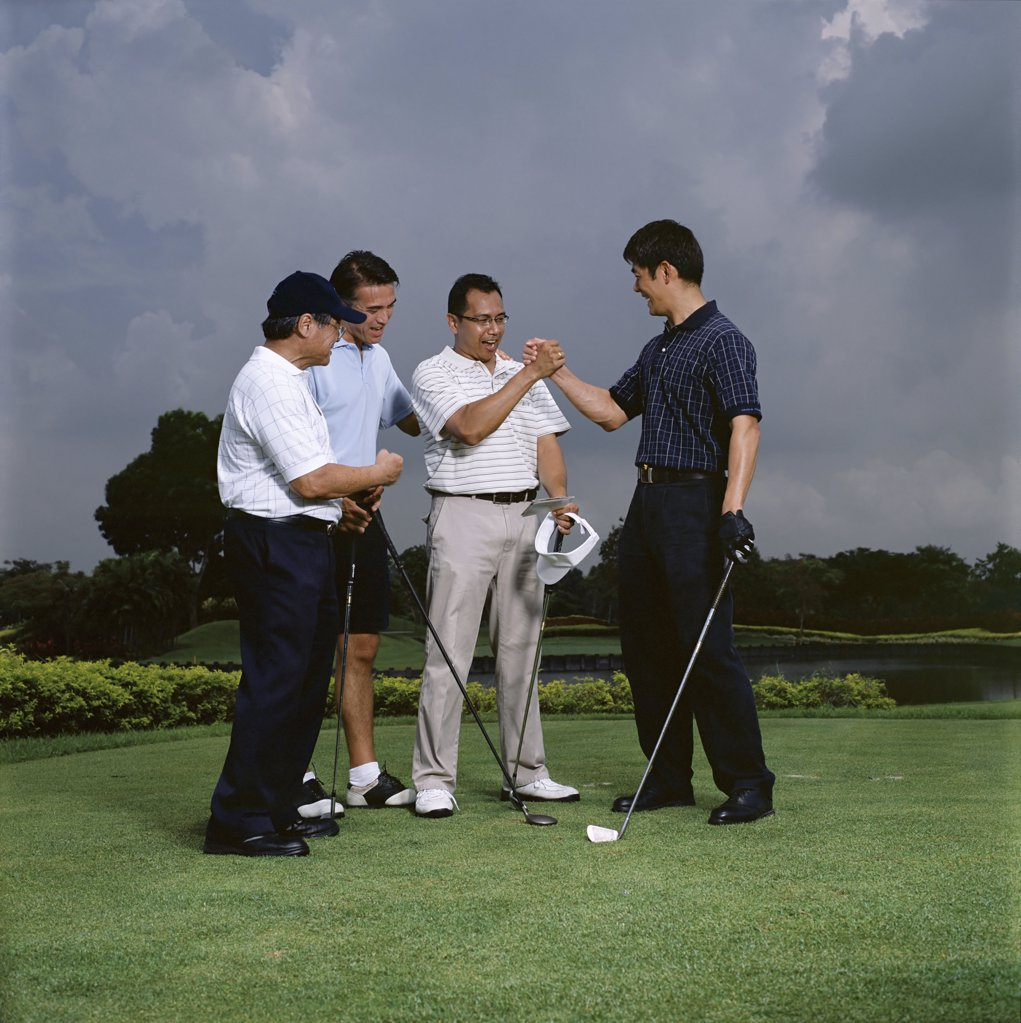Golfers celebrating : Stock Photo
