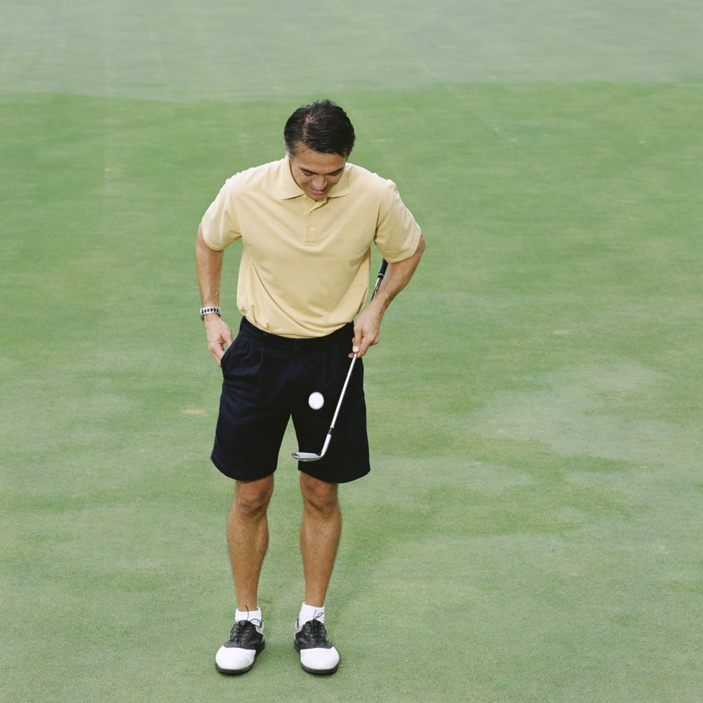 Male golfer on green : Stock Photo