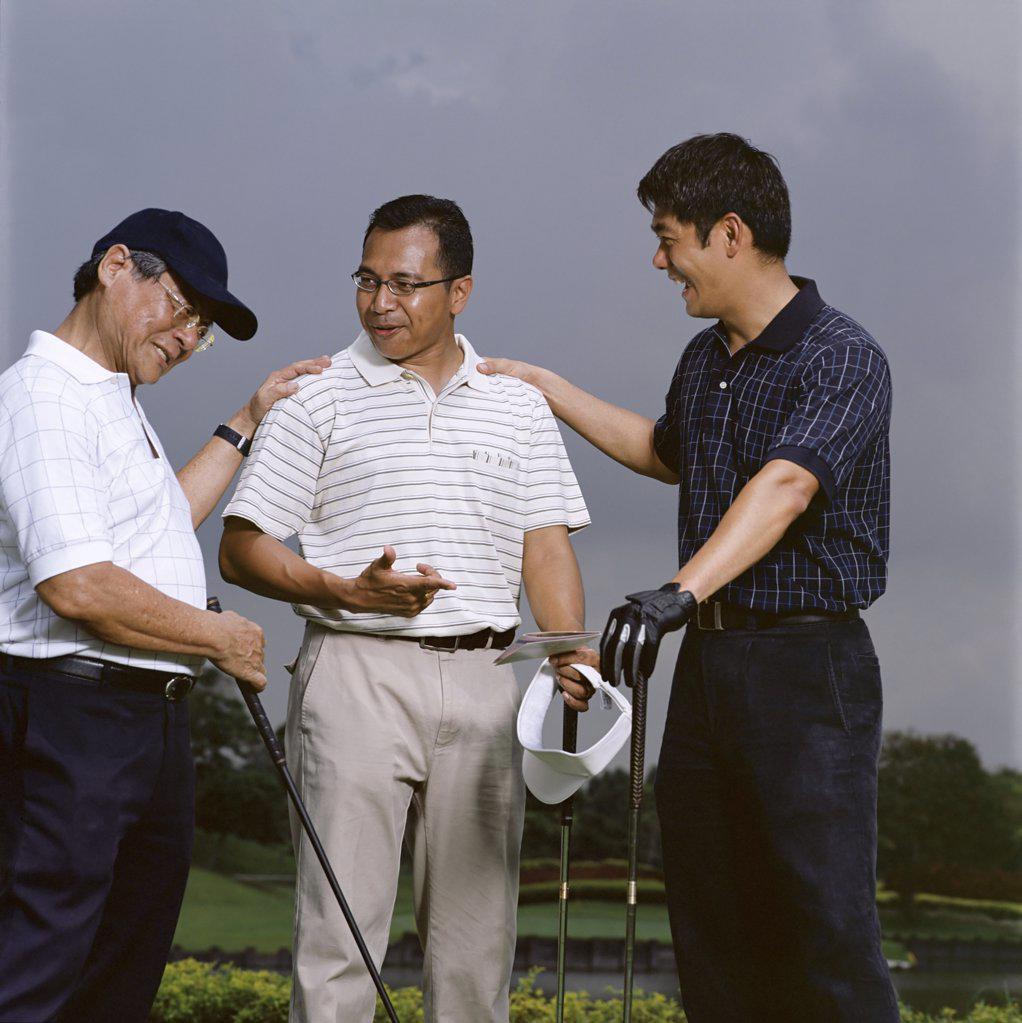 Golfers celebrating : Stock Photo