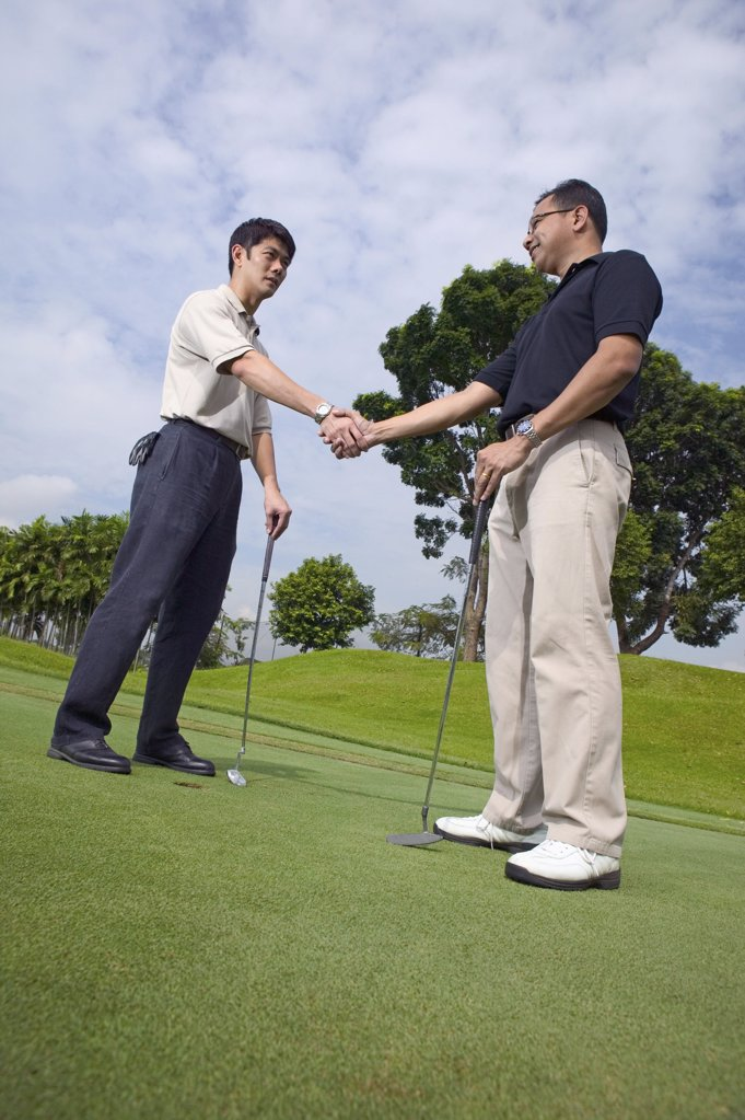 Stock Photo: 1439R-05373 Two men playing golf