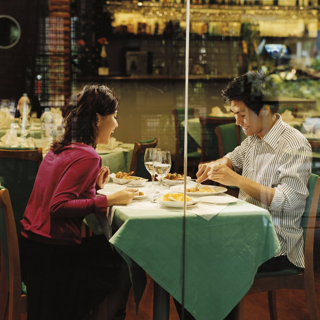Stock Photo: 1439R-05443 Young couple in restaurant