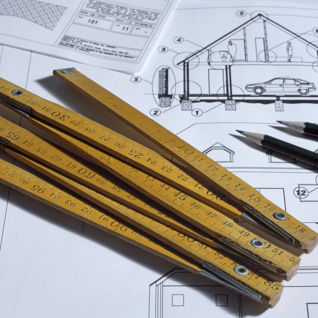 Extendable ruler and architectural blueprints : Stock Photo