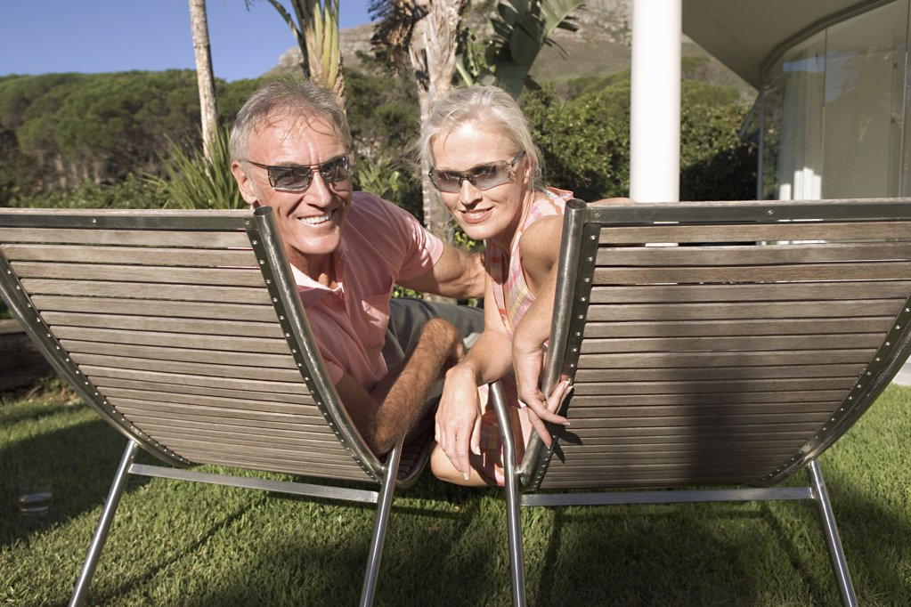 Stock Photo: 1439R-07009 Mature couple in lounge chairs
