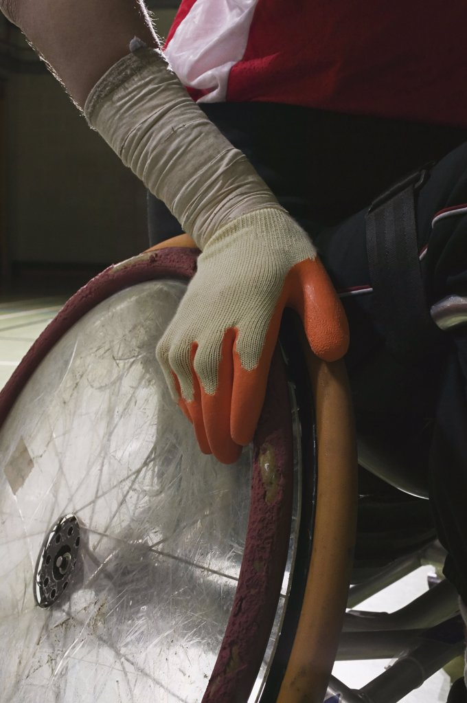 Stock Photo: 1439R-07136 Close-up of hand on a wheelchair
