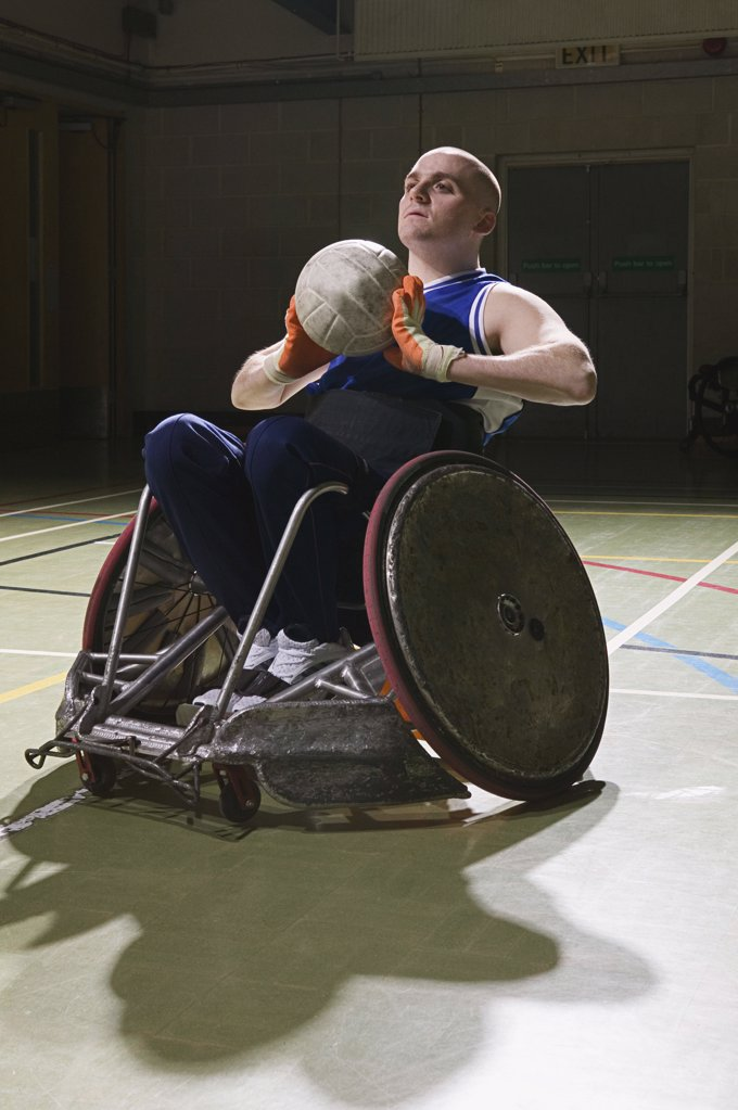Basketball player in a wheelchair : Stock Photo