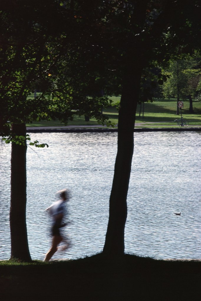Stock Photo: 1439R-09141 Blurred jogger in park