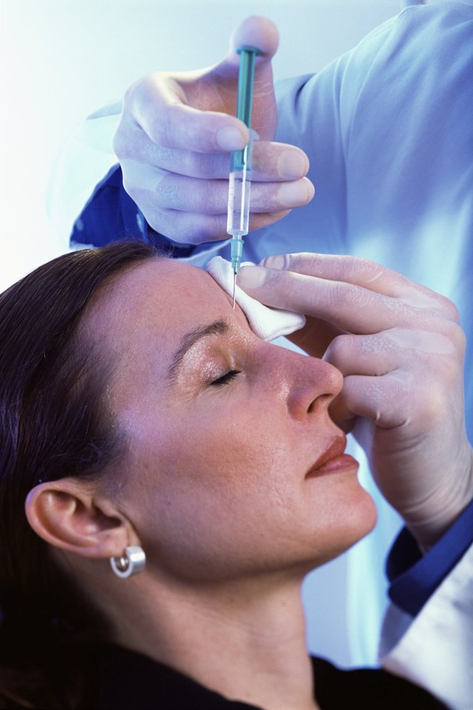 Stock Photo: 1439R-09572 Woman having botox injections