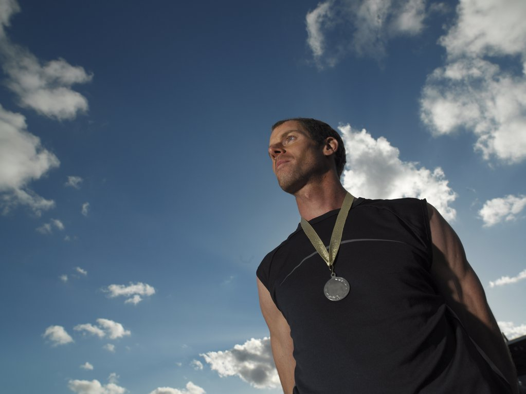 Male athlete wearing a medal : Stock Photo