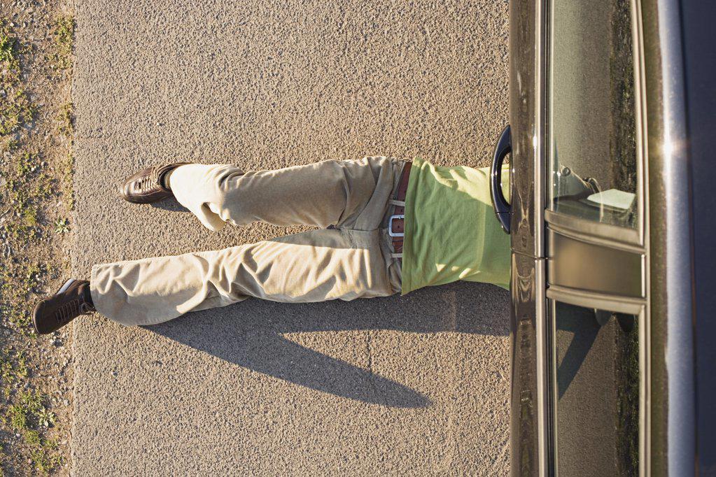 Man under a car : Stock Photo