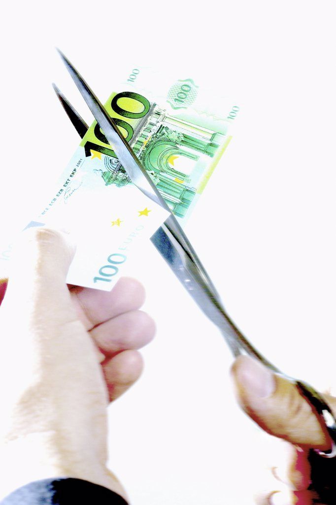 Cutting a banknote : Stock Photo