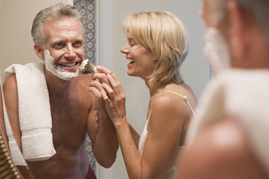 Woman helping husband shave : Stock Photo