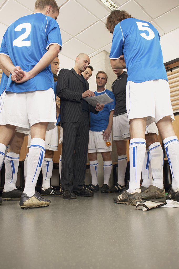 Coach with football team : Stock Photo
