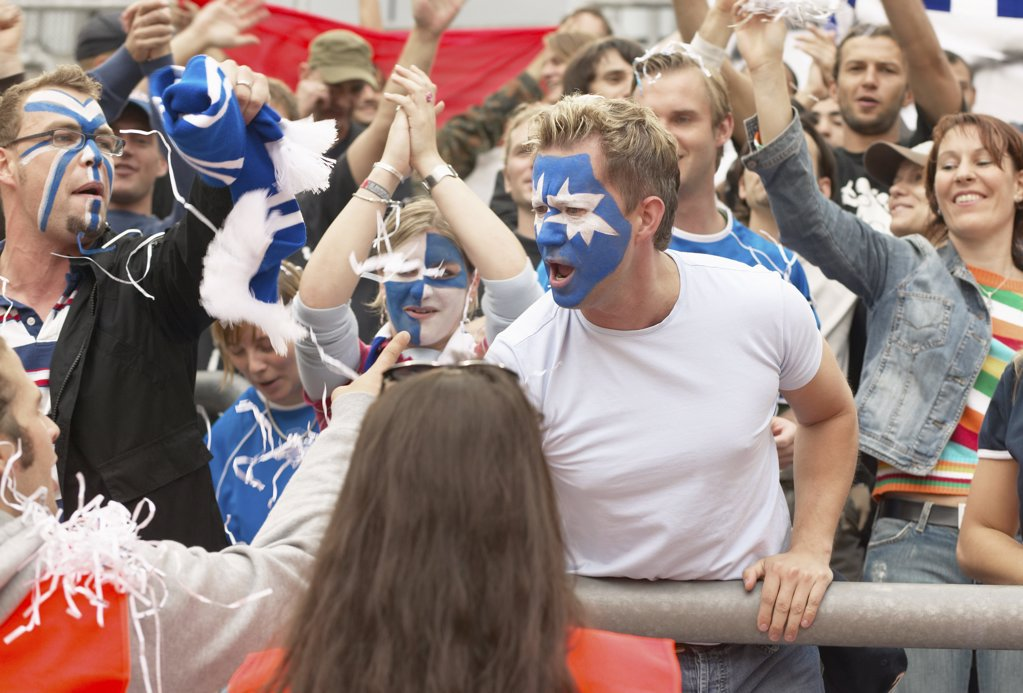 Aggressive man in football crowd : Stock Photo