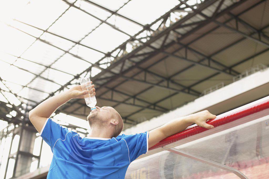 Stock Photo: 1439R-1000922 Footballer drinking