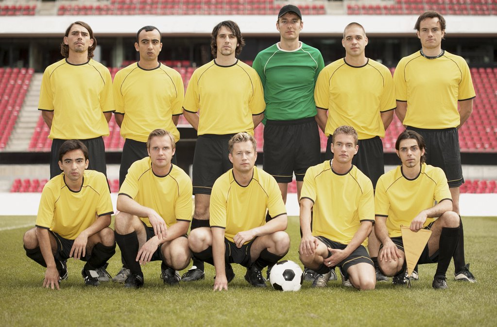 Football team in yellow : Stock Photo