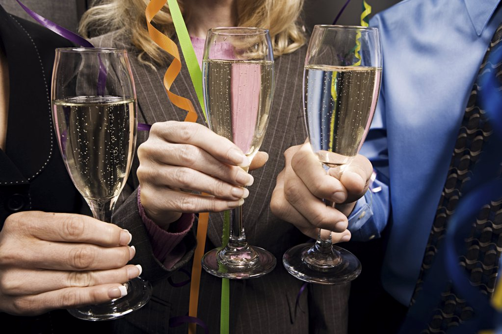 Office workers celebrating with champagne : Stock Photo
