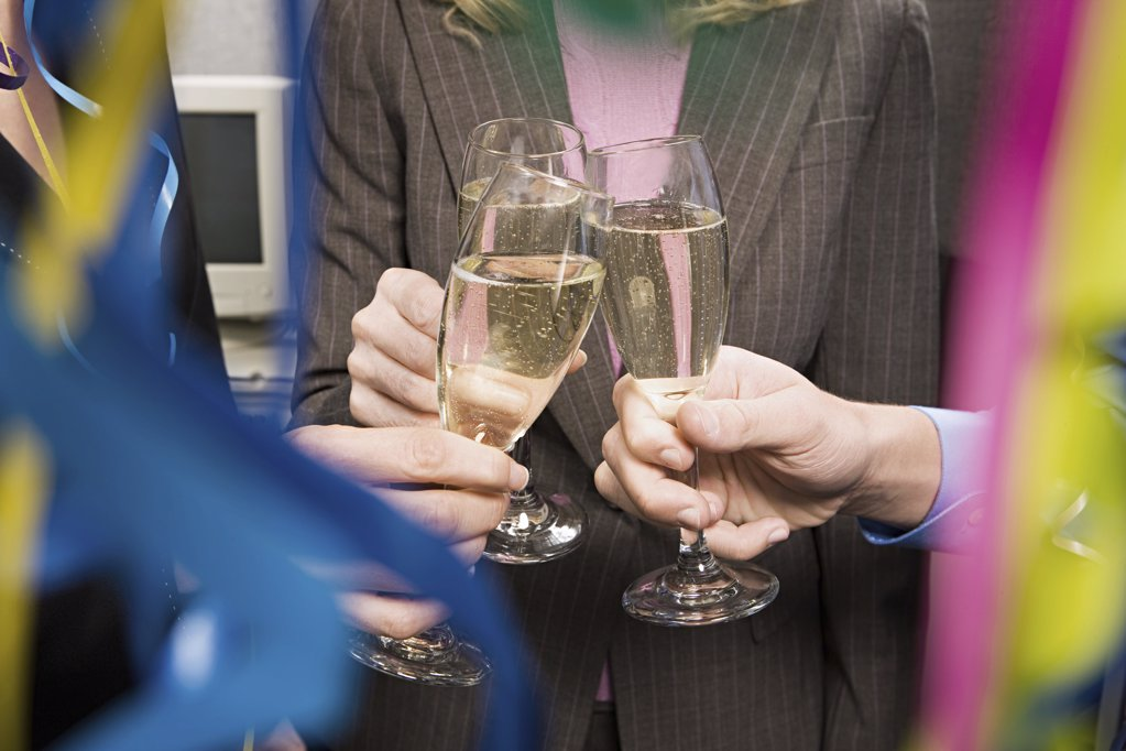 Office workers toasting with champagne : Stock Photo