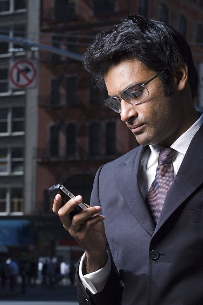 Businessman reading a text message : Stock Photo