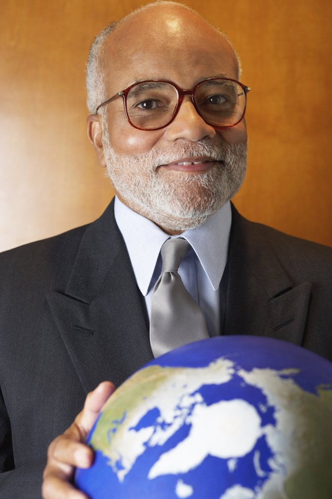 Stock Photo: 1439R-1002674 Ceo holding a globe