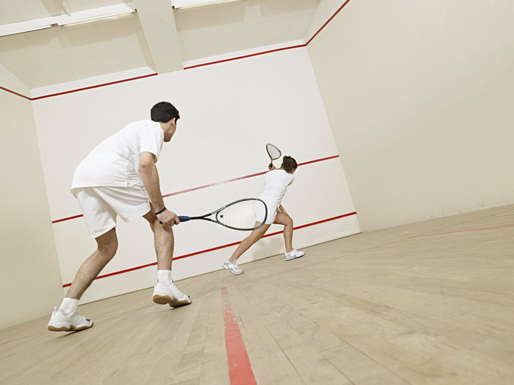 Stock Photo: 1439R-1003118 Man and woman playing squash