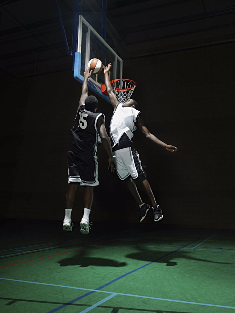 Rival basketball players : Stock Photo