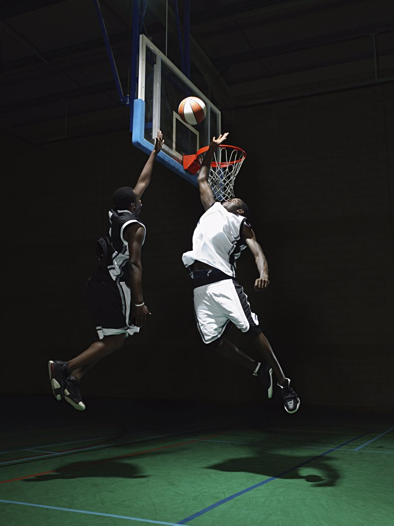 Stock Photo: 1439R-1003137 Rival basketball players