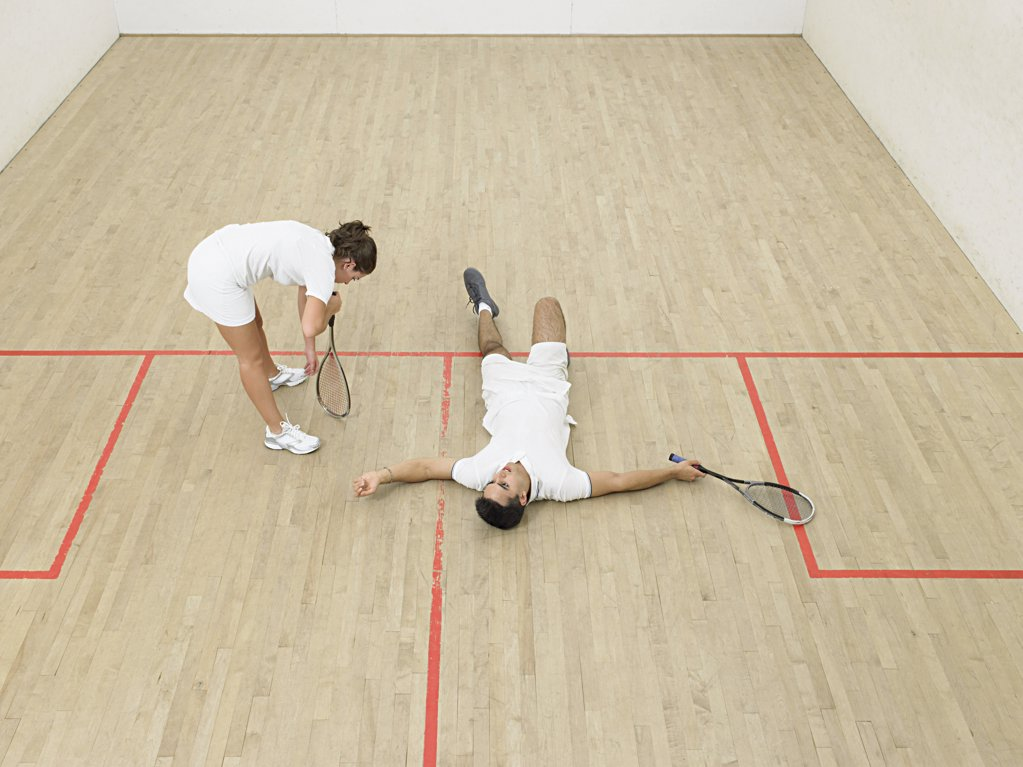 Exhausted squash players : Stock Photo