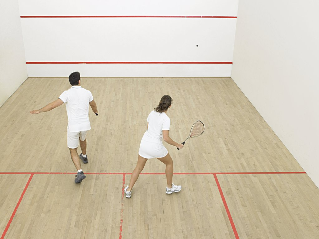 Stock Photo: 1439R-1003173 Man and woman playing squash
