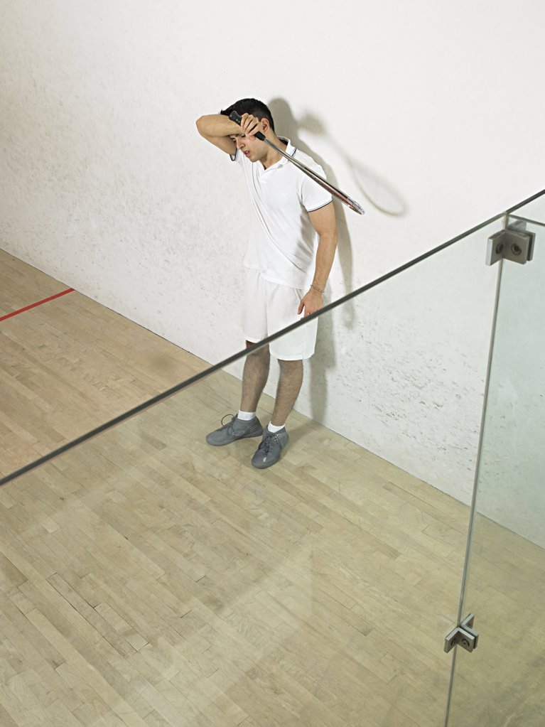 Stock Photo: 1439R-1003181 Tired squash player