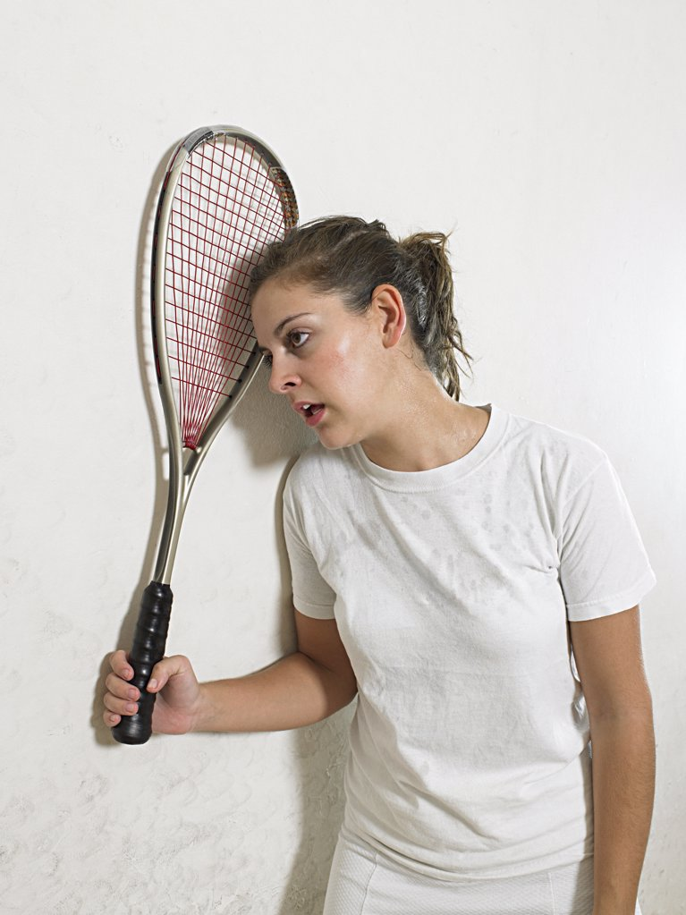 Stock Photo: 1439R-1003198 Exhausted squash player