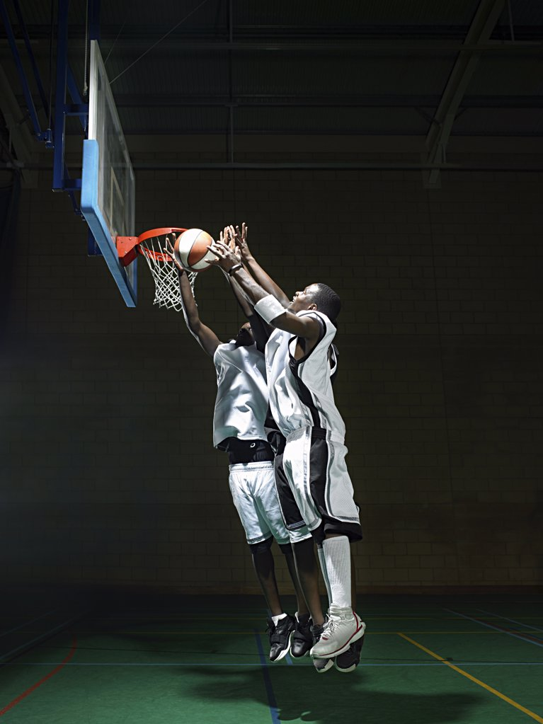 Basketball players by hoop : Stock Photo