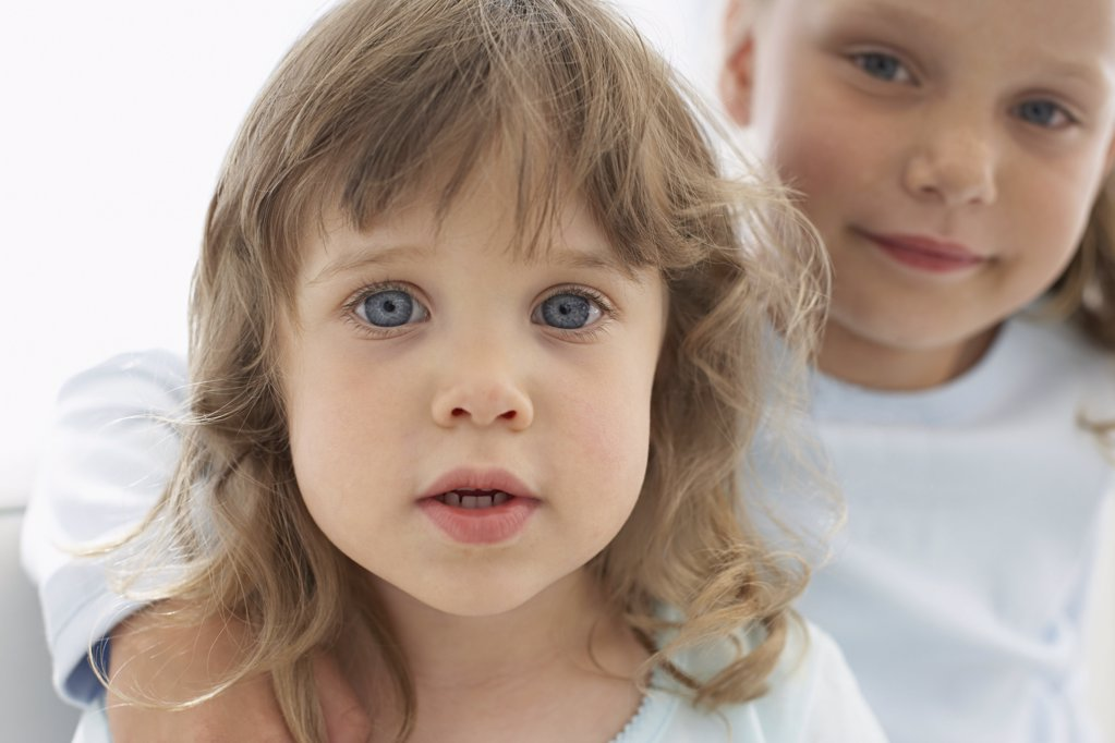 Stock Photo: 1439R-1003490 Portrait of two young sisters