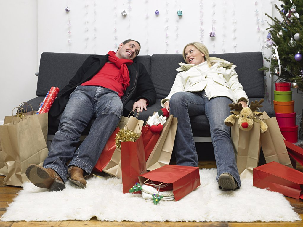 Couple exhausted after christmas shopping : Stock Photo