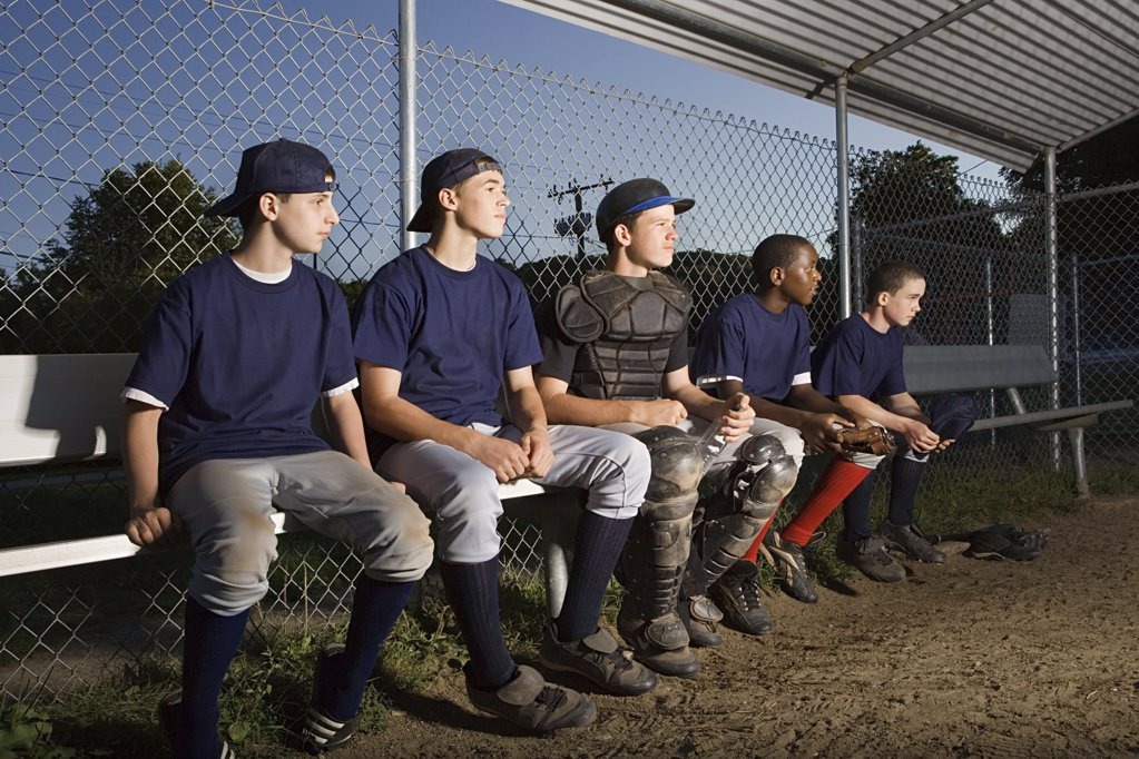 Stock Photo: 1439R-1004723 Five teenagers watching from the sidelines