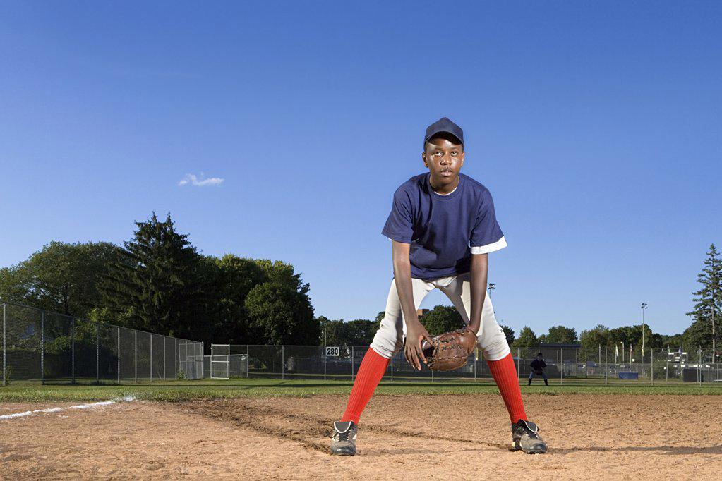 Stock Photo: 1439R-1004735 Teenage boy playing baseball