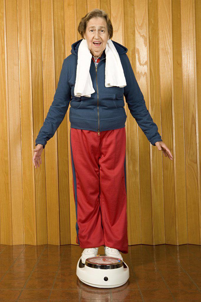 Senior woman stood on scales : Stock Photo