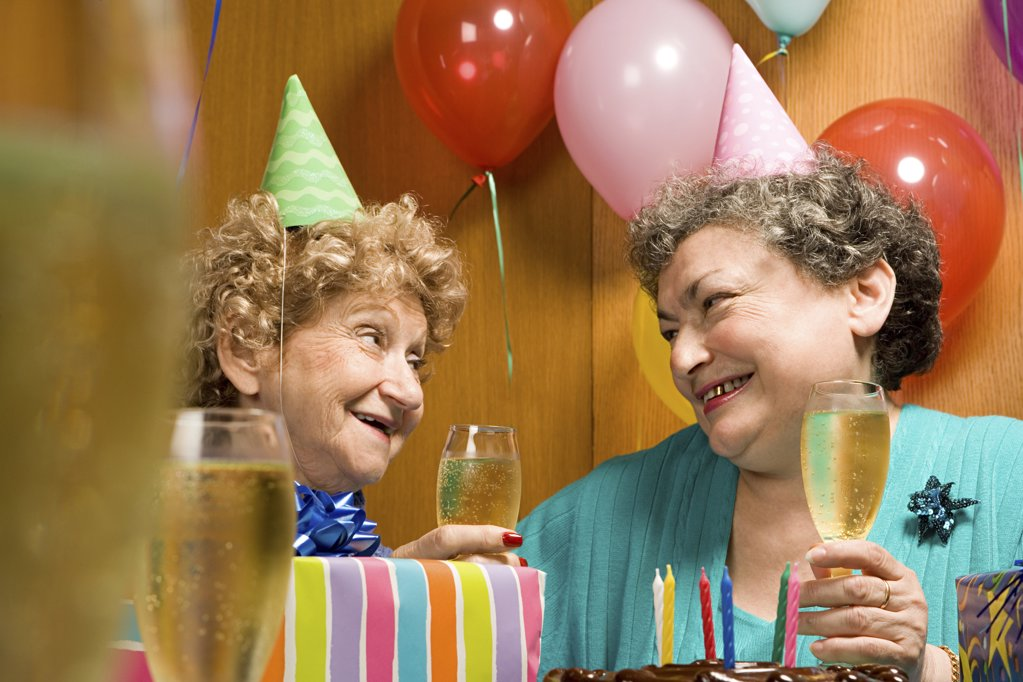 Two senior women at a party : Stock Photo