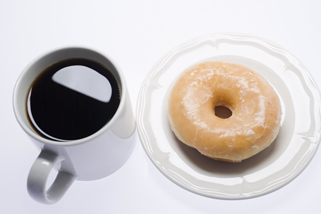 Coffee and a doughnut : Stock Photo
