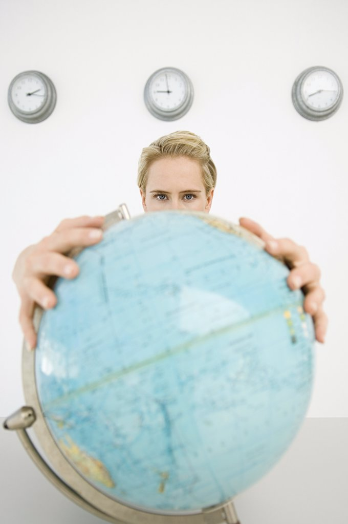 Businesswoman holding a globe : Stock Photo