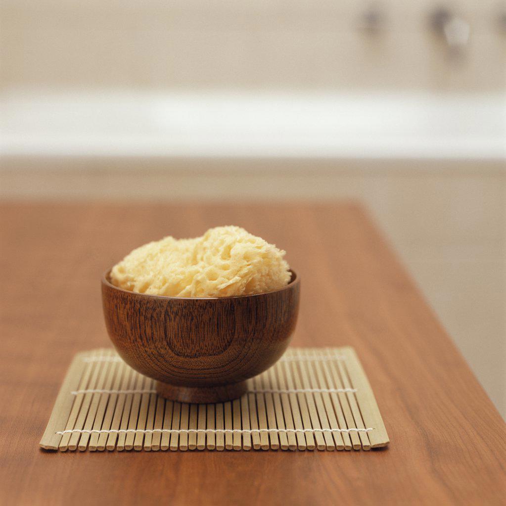 Sponge in a wooden bowl : Stock Photo