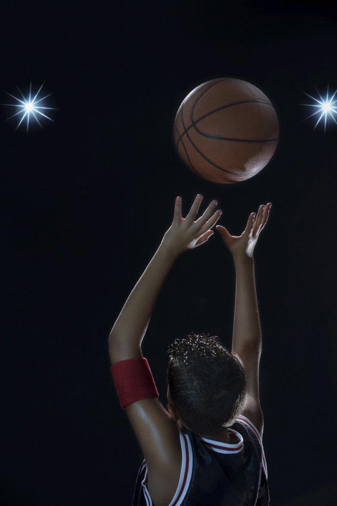 Stock Photo: 1439R-1005421 Boy playing basketball