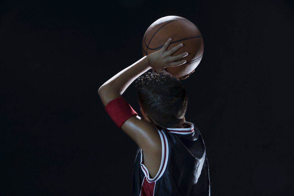 Boy laying basketball : Stock Photo