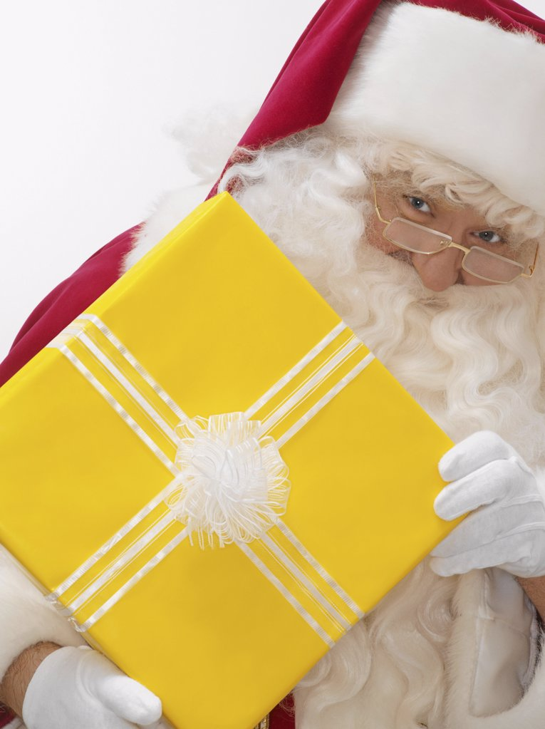 Santa with a present : Stock Photo