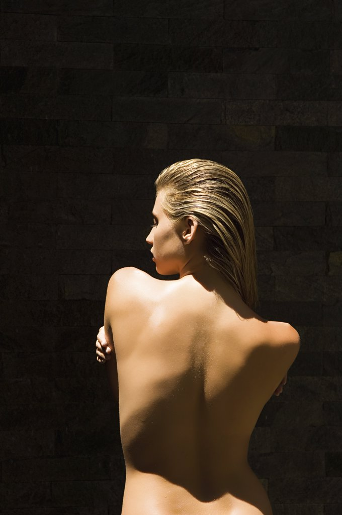 Stock Photo: 1439R-1006042 Rear view of naked woman