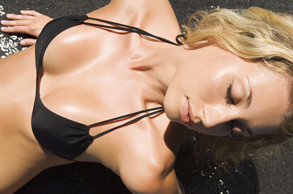 Stock Photo: 1439R-1006063 Woman in a bikini top