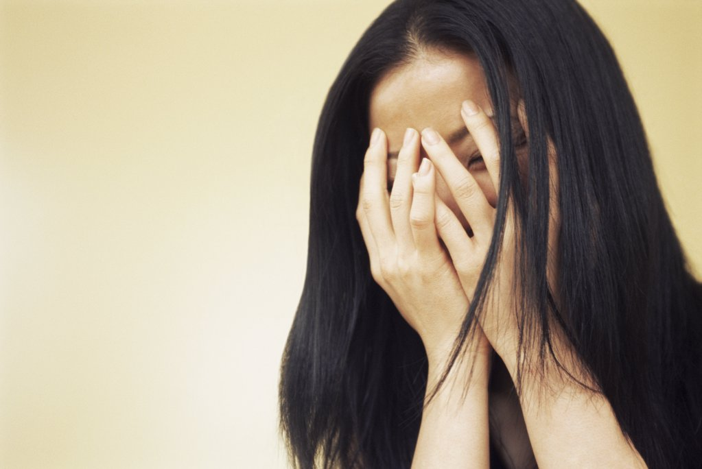 Woman covering her face : Stock Photo