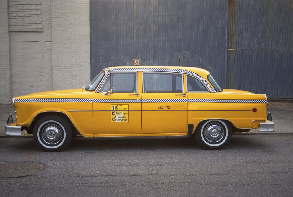 Stock Photo: 1439R-1006470 Parked yellow taxi cab new york