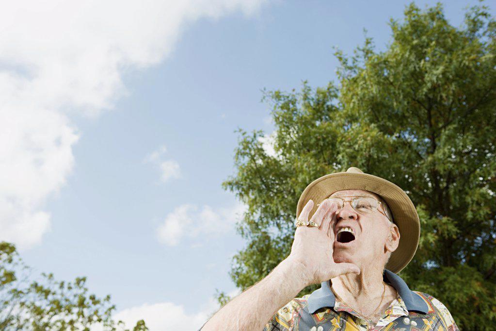 Senior man shouting : Stock Photo