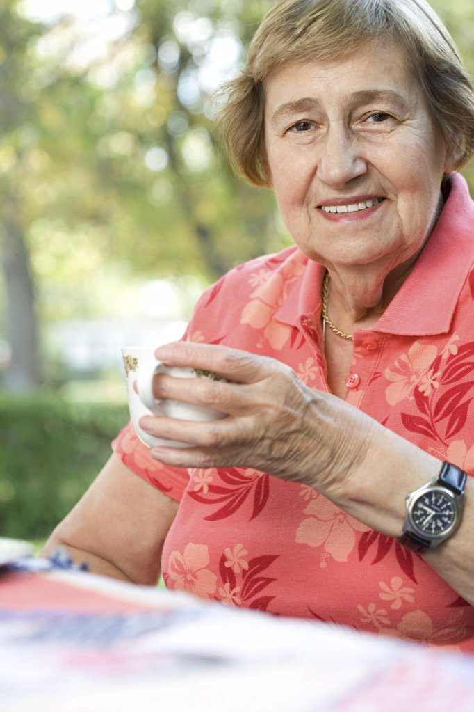 Stock Photo: 1439R-1006746 Senior adult woman drinking tea